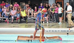 Meyers High School Students Propel Science in Cardboard Boat Regatta