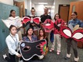 Students  from GAR Art class pose with their masks they painted for Semi Formal