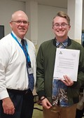 Mr. Gabriel (Principal, left) stands with Brandon Fuller (student, right)