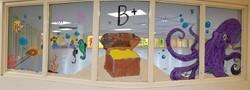 GAR Art students Paint windows for Heights Murray