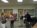 String Students Left to Right: Chloe Wilde, Michaela Barney, Brandon Prevuznak, Mrs. Lynn Hurst string faculty member