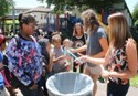 Mrs. Myers hands out popsicles to students from Heights-Murray Elementary
