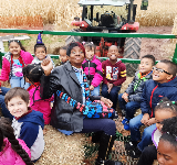Miss Pam and the kindergartners on the hayride!