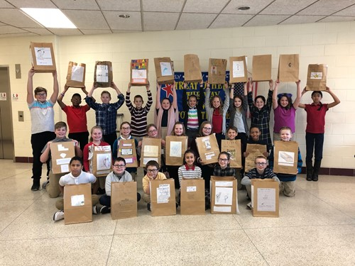 Students Displaying Paper Bag Book Reports