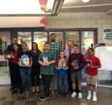 Solomon Plains Jr. high Students with books.