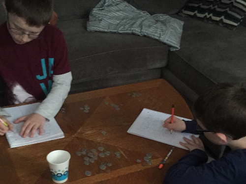 Jeremy and Justin Lyons counting money