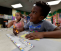 Jeremey Delcarmen stops and thinks while writting his name during the Power Scholars Academy at Kistler Elementary in Wilkes-Barre Thursday.