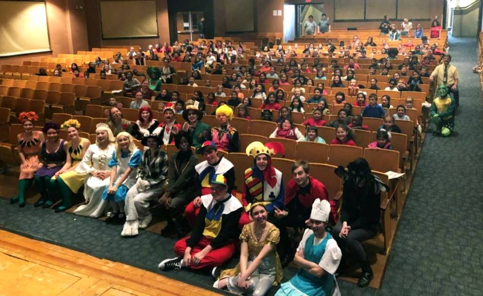 The Alice in Wonderland poses with 1st, 2nd, 3rd Graders from Dodson after their school day performa