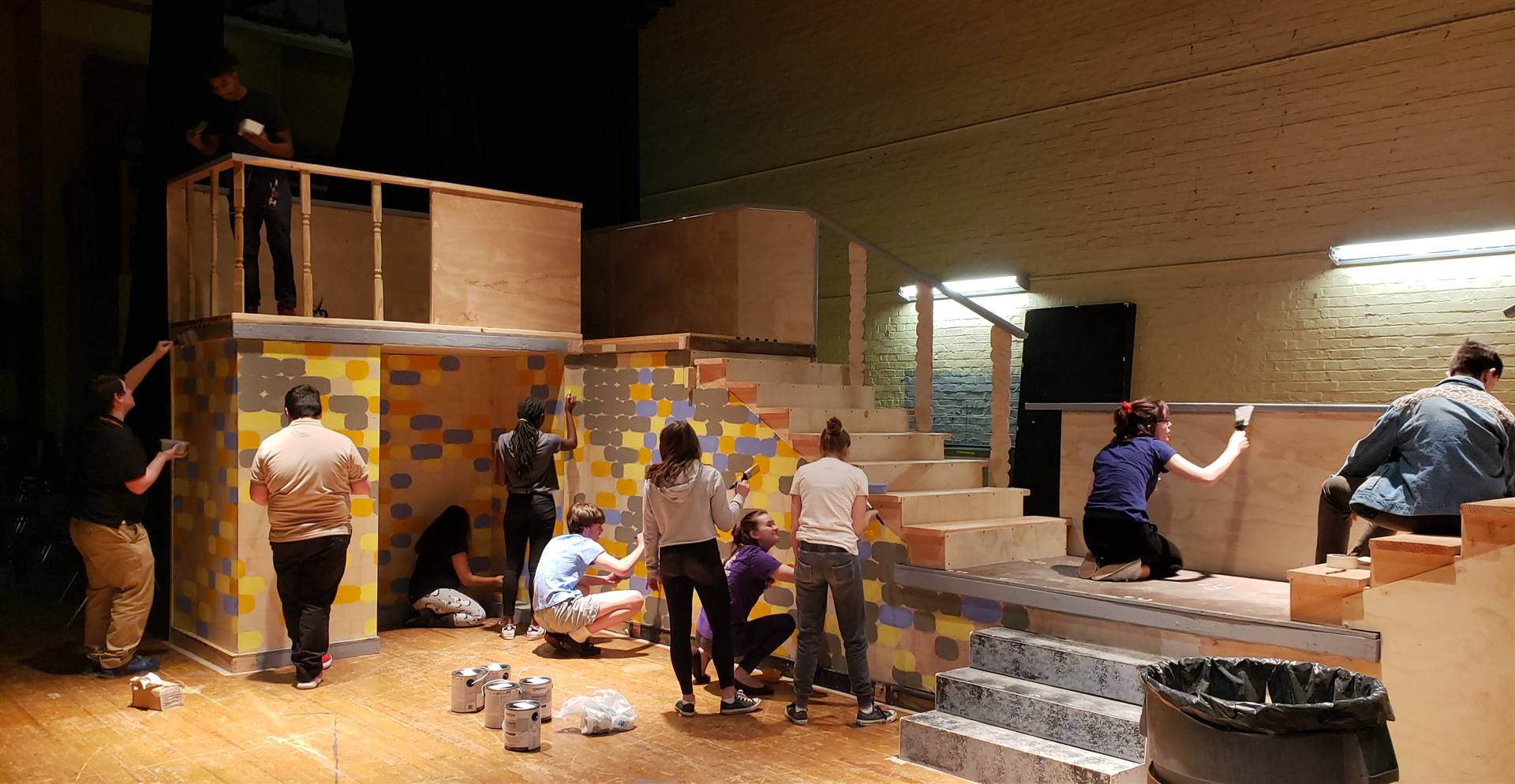 Theatre Arts & Visual Arts Students Collaborating on Set Painting