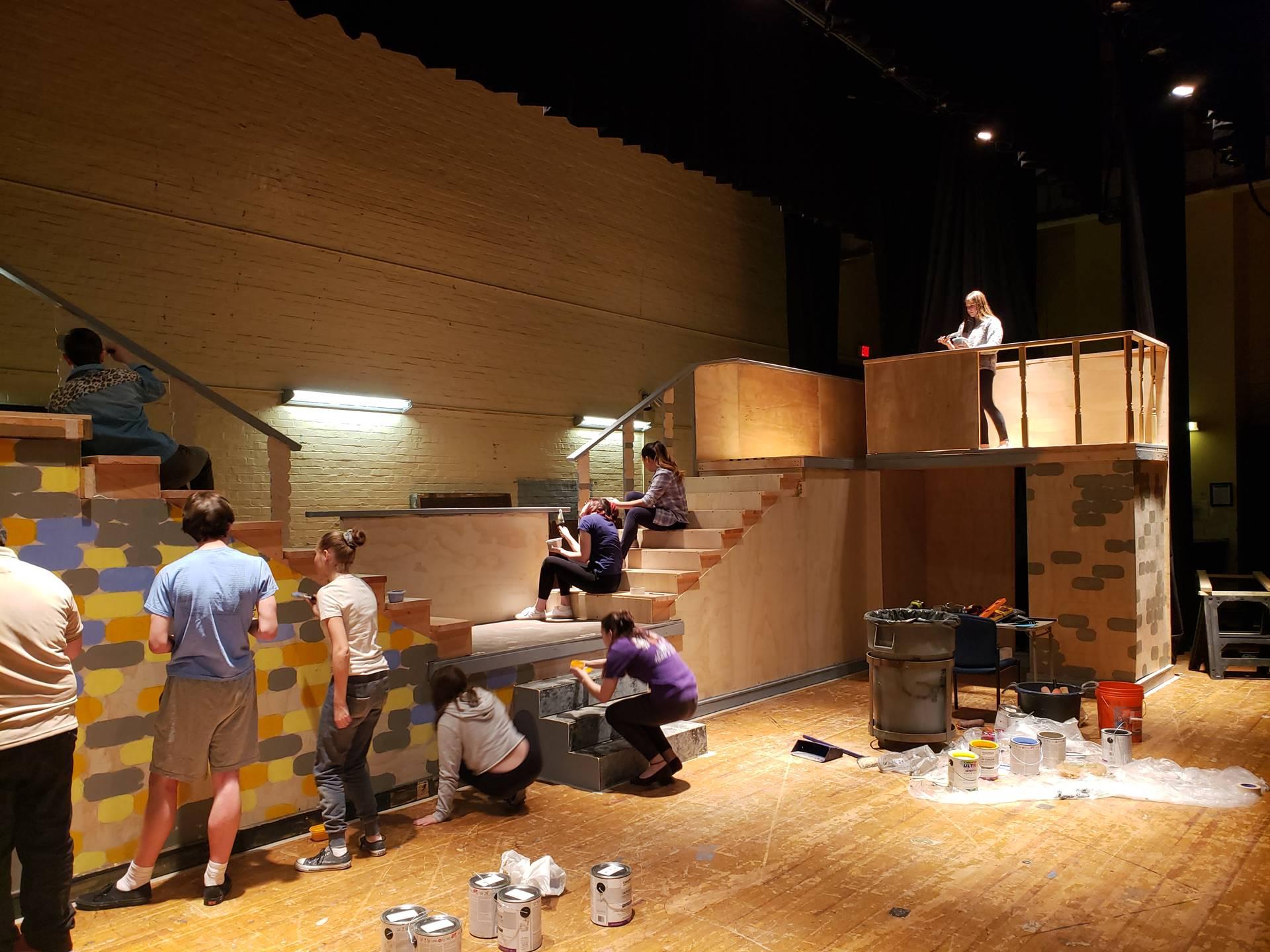 Theatre Arts & Visual Arts Students Collaborating on Set Painting
