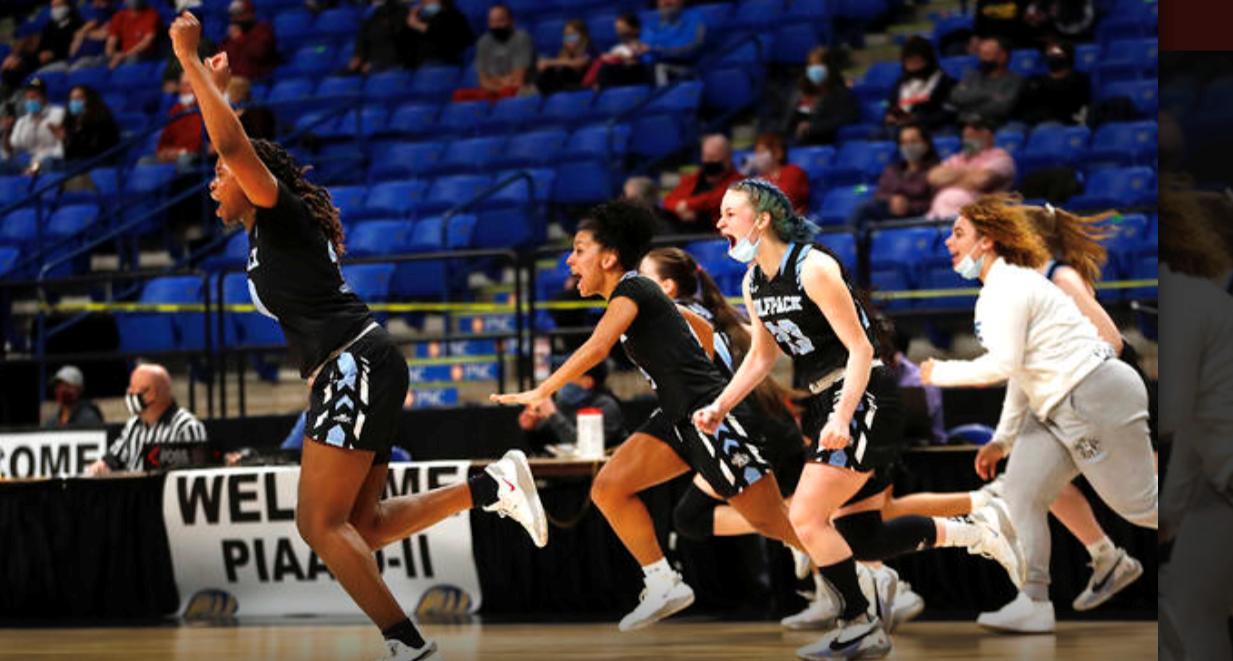 Wolfpack Girls Bball running onto court